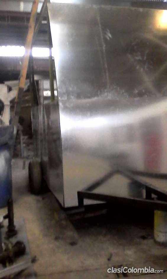 proceso de fabricación: trailer para comidas rapidas ya forrado con lámina galvanizada.